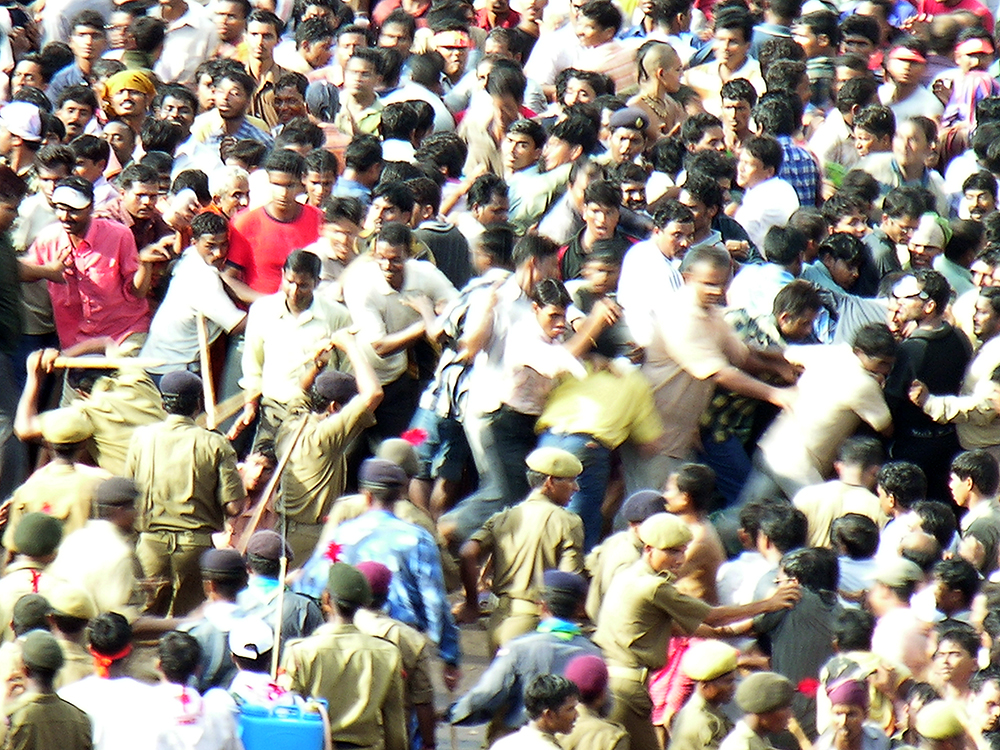 Police beat back the surging crowd