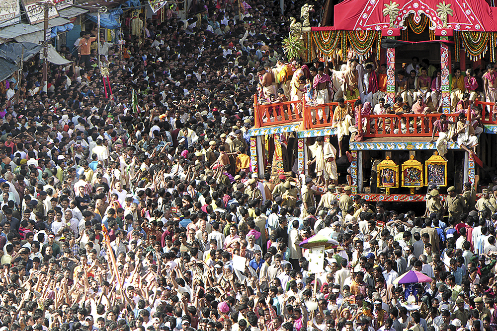 The crowd whips its self into a religious fervor as the chariots move down the street
