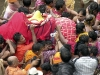 Devotees carry one of the dieties from the temple to the chariots