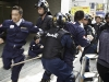 Members of Japanese right wing group Gishin Gokoku-kai clash with the Police whilst trying to attack a  left wing Peace march.Near to Yasukuni shirine, Kudanshita, Tokyo on Aug 15th 2010, the anniversary of the Japanese surrender at the end of World War II.