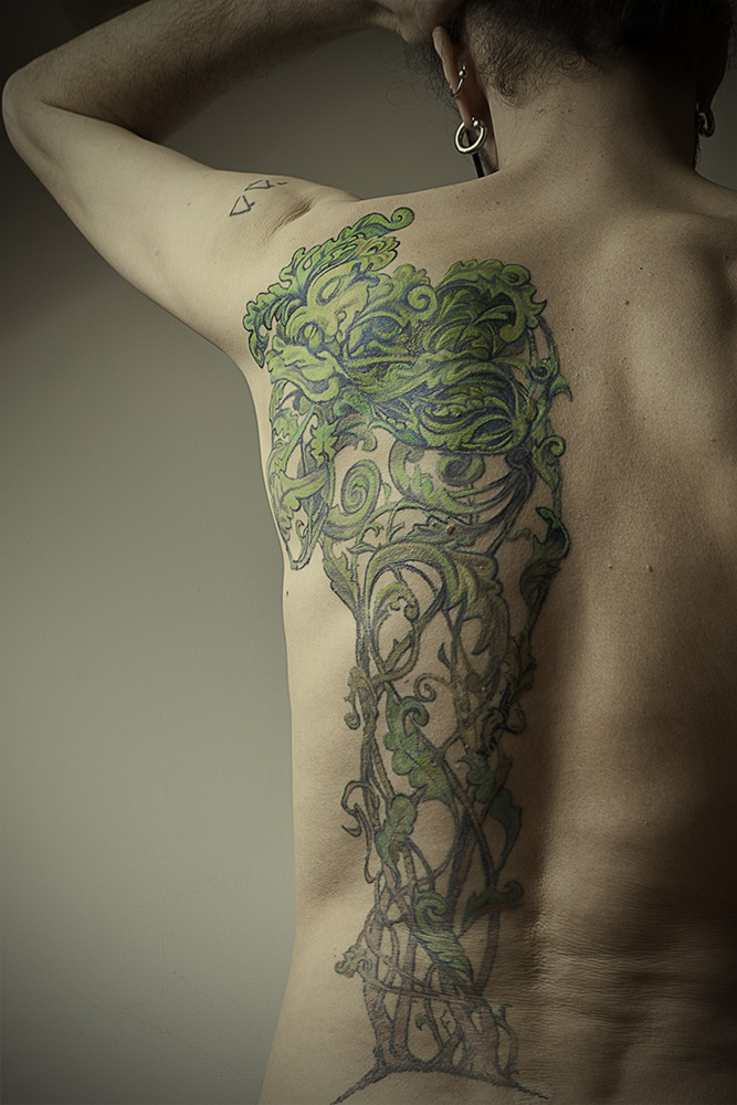 Uchujin's back tattoo-design by John Storey, Tattoo by Abdullah Taqy