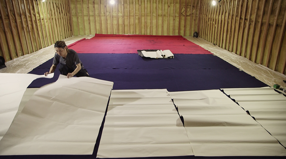 Koji Kakinuma laying out paper ©Uchujin-AdrianStorey